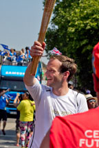 Ben Fenton with the Olympic Torch in Brixton