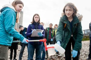 Water quality testing on the tidal Thamesforeshore. Photo by Corporate Headshots London