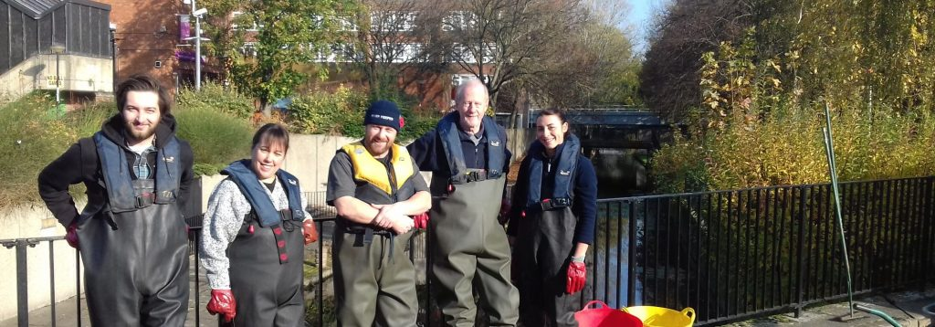 volunteers by canal fence